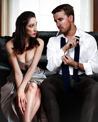 man sitting on a sofa with a woman