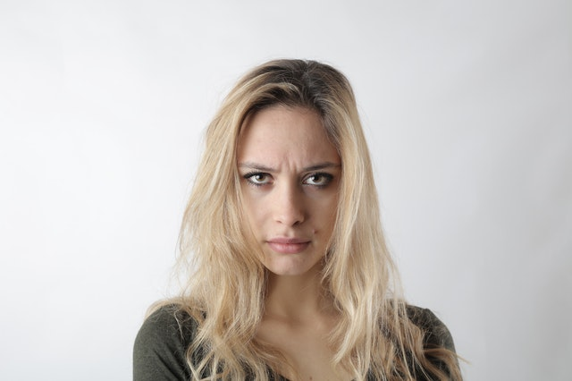 portrait photo of woman frowning
