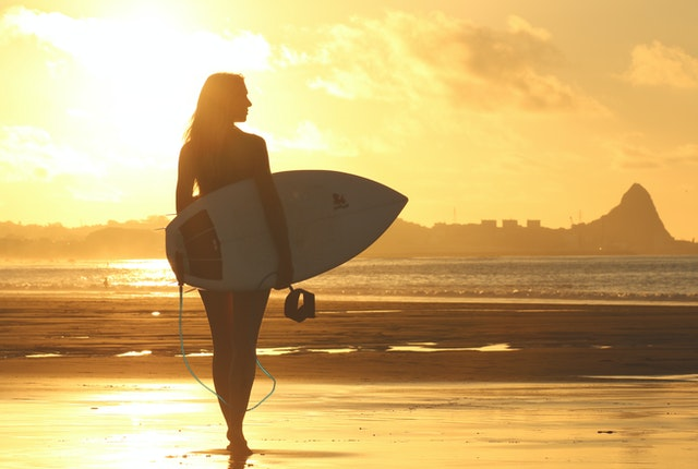 woman surfing in the beach