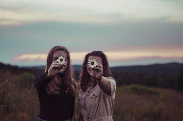 women holding a white flower