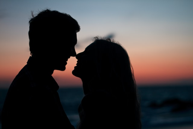 silhouette of a couple smiling with each other