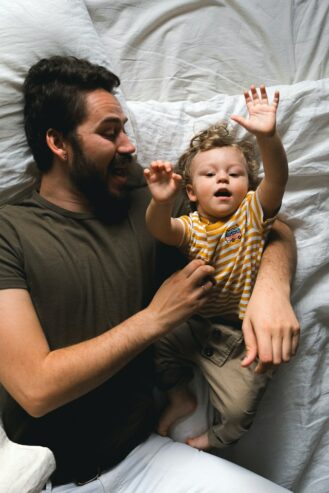 man with his son in bed