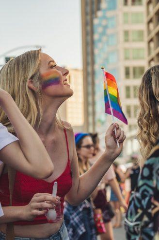 woman holding a rainbow flag