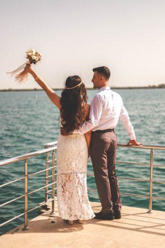 married couple standing near metal railings