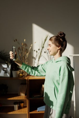 girl taking a photo using a smartphone