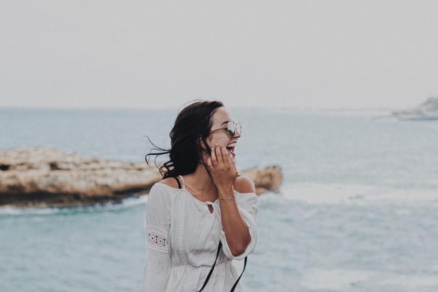 woman wearing shades smiling